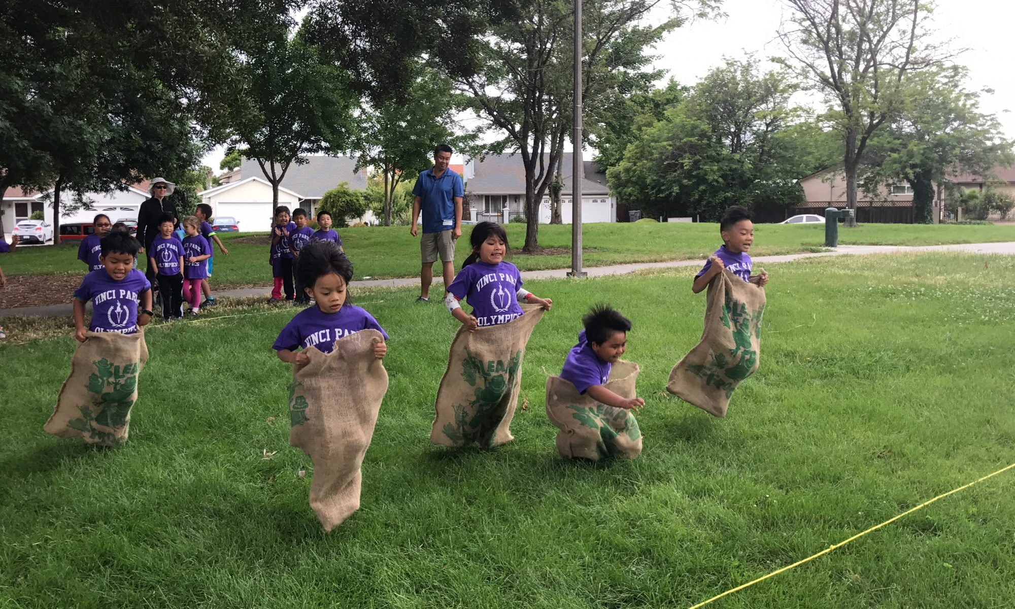 Kinder kids doing the sack race.